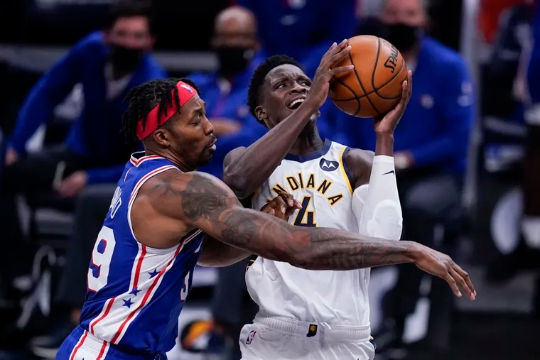 The Pacers' Victor Oladipo (4) is fouled by the Sixers' Dwight Howard (39) as he goes up for a shot during the second half of Friday's preseason finale in Indiana.