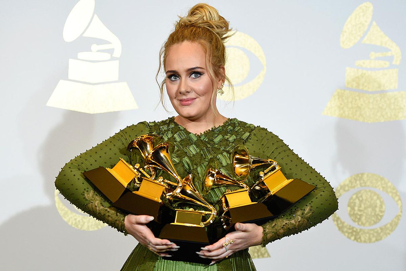 Adele tops Beyonce at the Grammys, seems almost embarrassed by it
