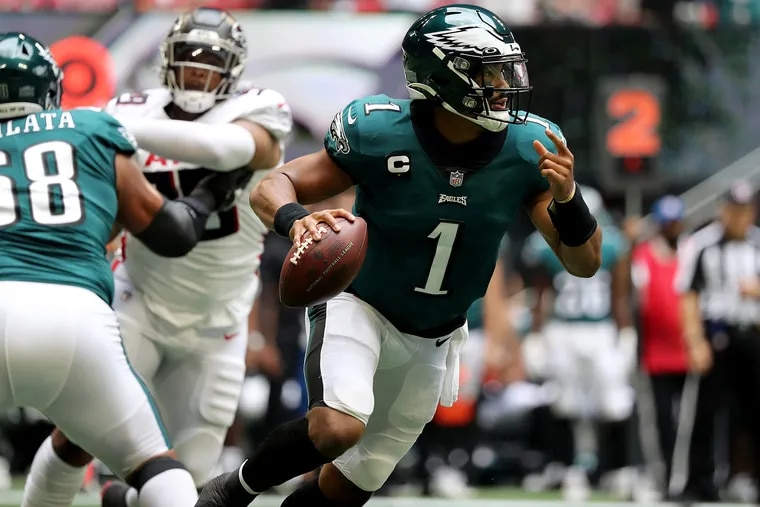 Philadelphia Eagles quarterback Jalen Hurts looks for an open receiver in the second quarter as the Eagles play the Falcons at Mercedes-Benz Stadium in Atlanta, Ga. on Sunday, September 12, 2021. .