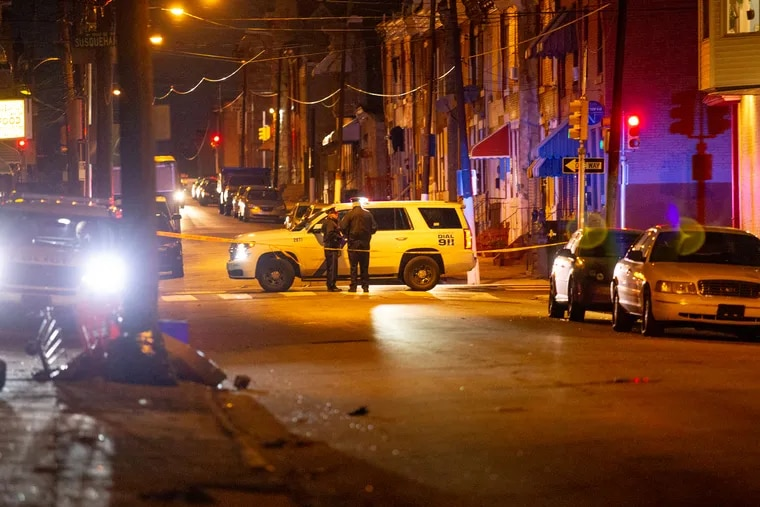 A shooting in North Philadelphia on 10th street near French St. left three people dead Saturday, December 22, 2018. MARGO REED / Staff Photographer