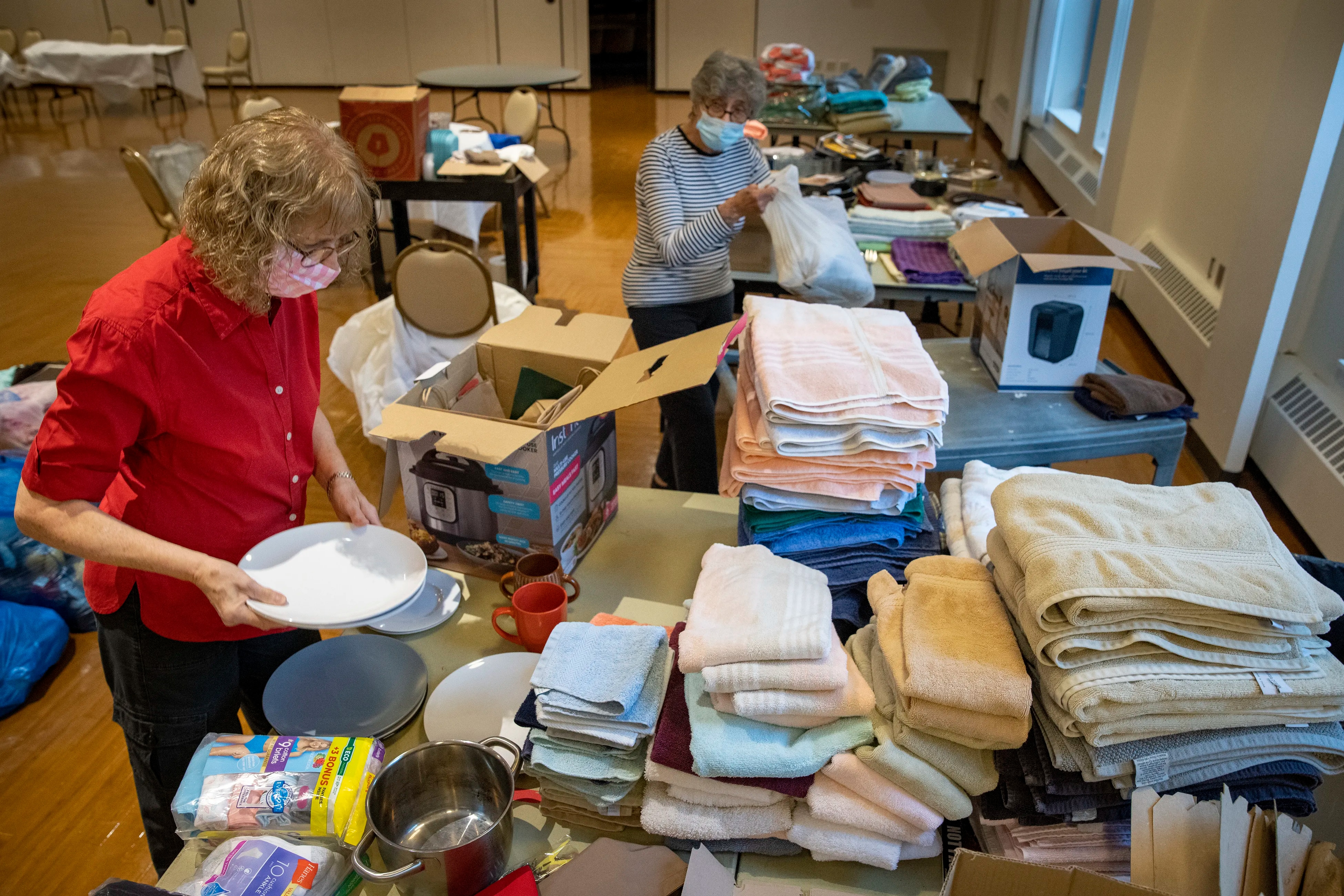 Linda Brock (left) and Adele Margulies organizing donations to HIAS Pennsylvania on Thursday afternoon at the Main Line Reform Temple in Wynnewood.