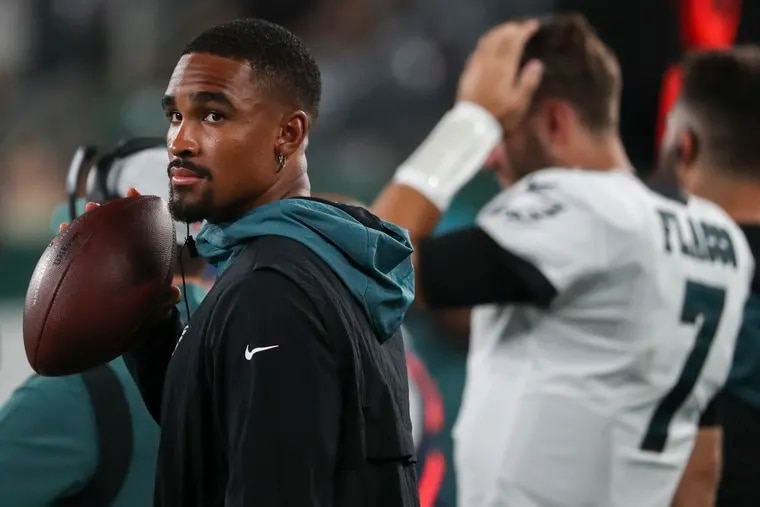 Eagles quarterback Jalen Hurts stands on the sideline in the fourth quarter of the preseason game against the New York Jets.