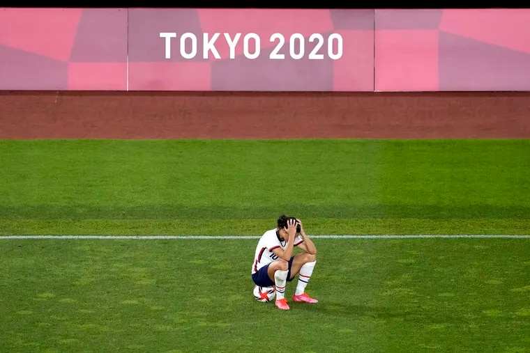 Carli Lloyd sits alone after the game ended.