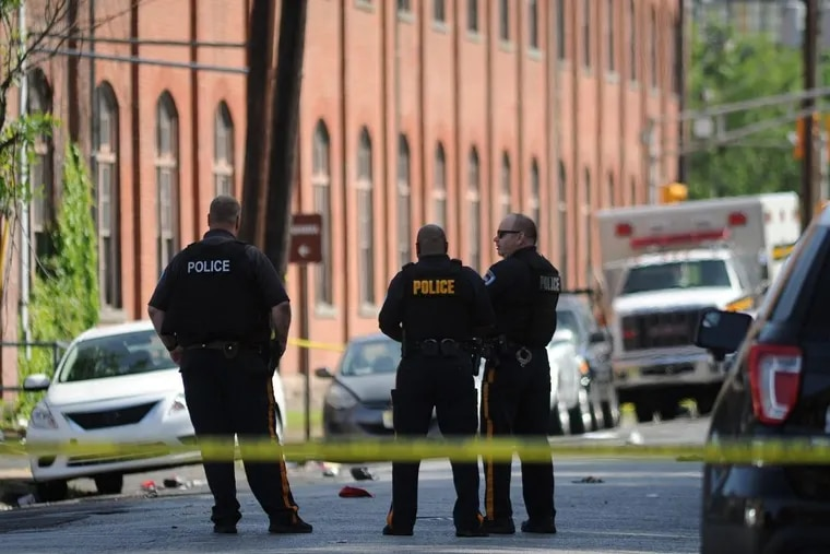 Police personnel investigate at the scene of Art All Night Trenton 2018 where 17 people were shot and 5 people were injured early in the morning Sunday, June 17, 2018 in Trenton, New Jersey.
