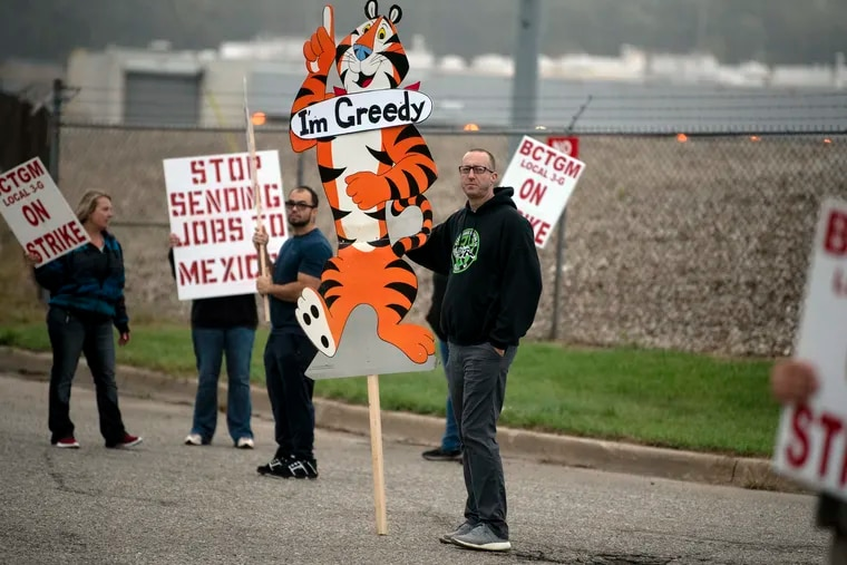 First-shift worker Travis Huffman joins other BCTGM Local 3G union members in a strike against Kellogg Co. on Tuesday, Oct. 5, 2021 at the Kellogg plant on Porter Street in Battle Creek, Michigan. Workers in Battle Creek, Lancaster, Memphis and Omaha walked out at 1 a.m., demanding livable wages and better benefits.
