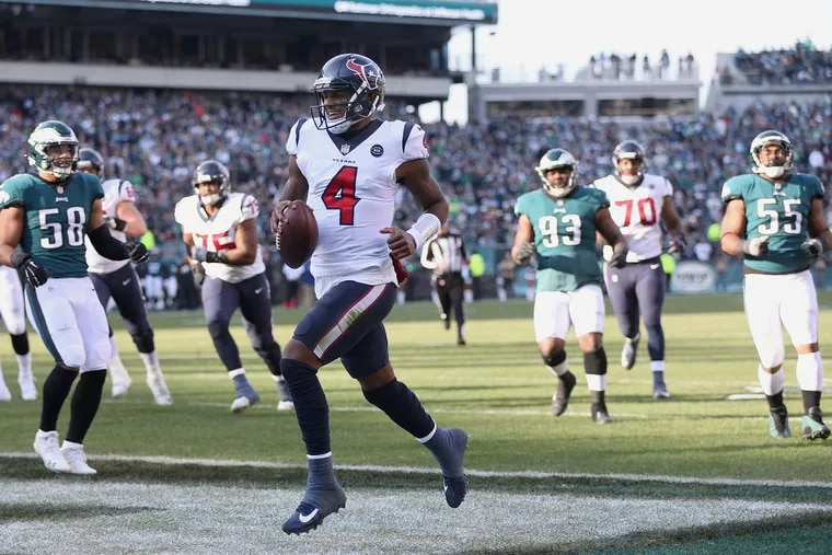 Houston Texans quarterback Deshaun Watson (4) runs for a touchdown in the second quarter of a game against the Eagles at Lincoln Financial Field in South Philadelphia on Sunday, Dec. 23, 2018.