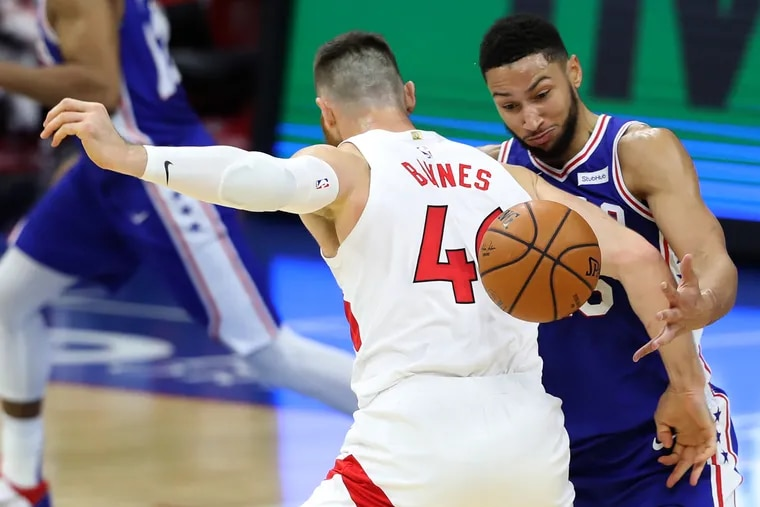 Ben Simmons of the Sixers comes up with a steal and gets fouled by Aron Baynes of the Raptors during the first half.