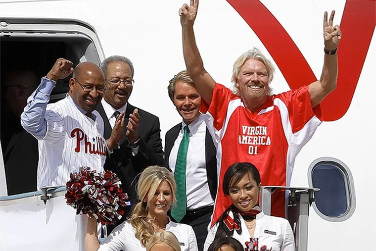 Among those heralding Virgin America's arrival in Philadelphia in April 2012, were (from left) Mayor Nutter, Rep. Chaka Fattah, Virgin America president and CEO David Cush, and Virgin Group founder Richard Branson. The airline is now pulling out.