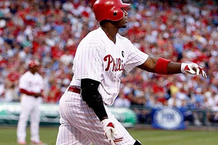 Ryan Howard watches the flight of his second inning home run against the Rangers' Colby Lewis. (Ron Cortes/Staff Photographer)