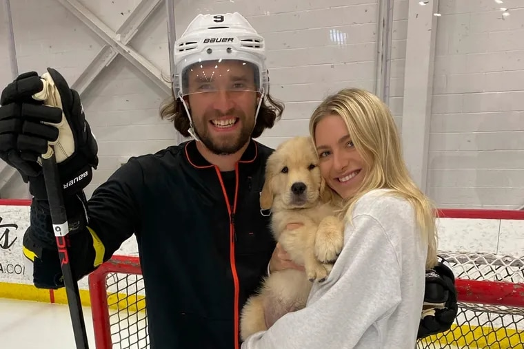 Drake posing with his dad, Flyers defenseman Ivan Provorov, and mom, Madison Fairhurst, on the ice at the Flyers practice facility this summer.