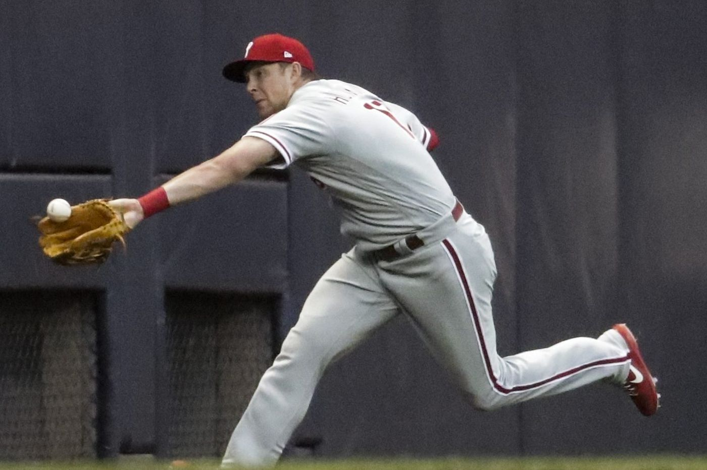 Phillies defense fails Jake Arrieta in blowout loss to Brewers
