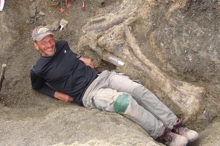 The dig site for Dreadnoughtus schrani in Argentina.  Dr. Kenneth Lacovara poses by the tibia.  Handout from Drexel University.