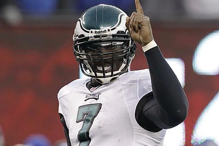 Michael Vick and the Eagles will play in the first Tuesday NFL game in 64 years. (Kathy Willens/AP File Photo)