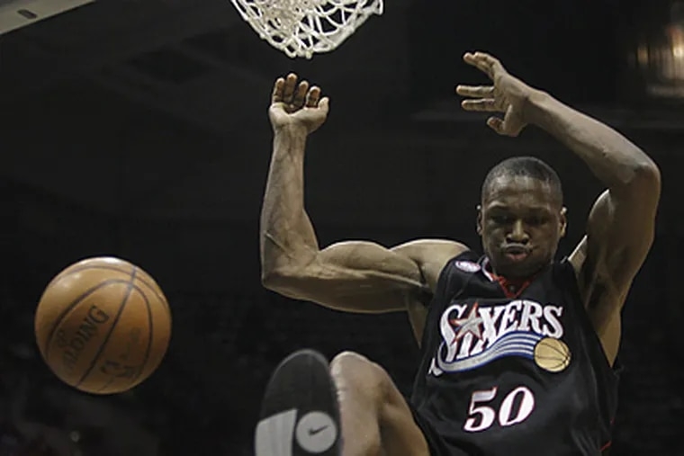 Theo Ratliff throws down a dunk against Milwaukee. (Morry Gash / AP)