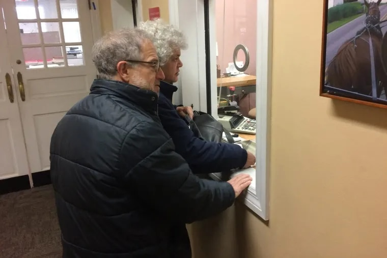 Gail Trachtenberg and Lewis Eron prepay part of their 2018 property tax bill at the township building in Cherry Hill, New Jersey, on Thursday, Dec. 22, 2017. People across the country have been trying to prepay property taxes before a federal tax overhaul kicks in and caps deductions for state and local taxes. (AP Photo/Geoff Mulvihill)