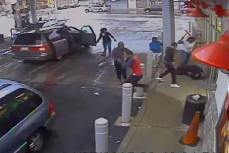 Surveillance video from the gas station in Olney shows several people, some armed with a chair leg or hammer, beating the victim, who's now in a medically induced coma.