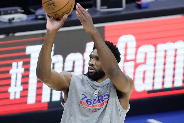 Sixers center Joel Embiid shoots the basketball during warm-ups before the Sixers play the Atlanta Hawks in Game 7 of the NBA Eastern Conference playoff semifinals on June 20.