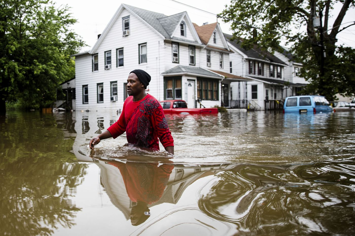 Chris Smith makes his way through floodwaters to the Macedonia Baptist Church in Westville, N.J., Thursday, June 20, 2019. Severe storms with heavy rains and strong winds spurred flooding across southern New Jersey, disrupting travel and damaging some property. (AP Photo/Matt Rourke)