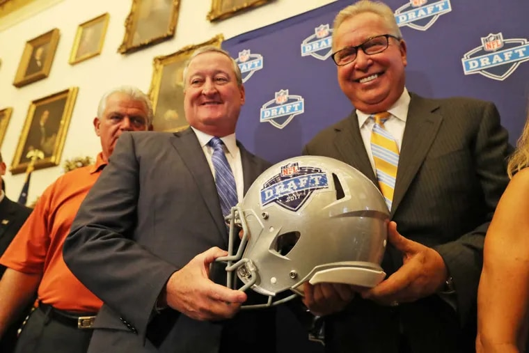 """Mayor Kenney (left) and former Eagle Ron Jaworski confirm the big catch. """"As a lifelong Eagles fan … I can't tell you how wonderful this is,"""" Kenney said."""