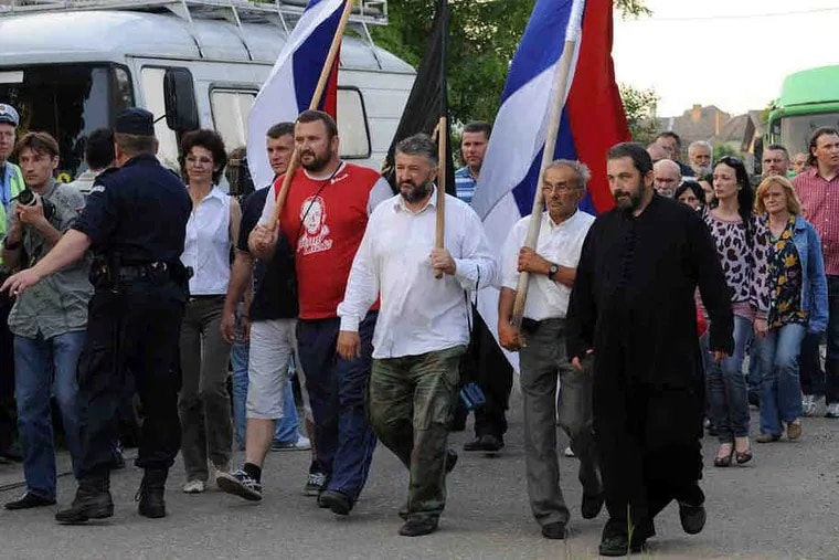 Some 150 pro-Mladic villagers protest in Lazarevo, where the general was arrested by Serbian intelligence. Villagers insisted they had no idea Mladic was living in their midst.