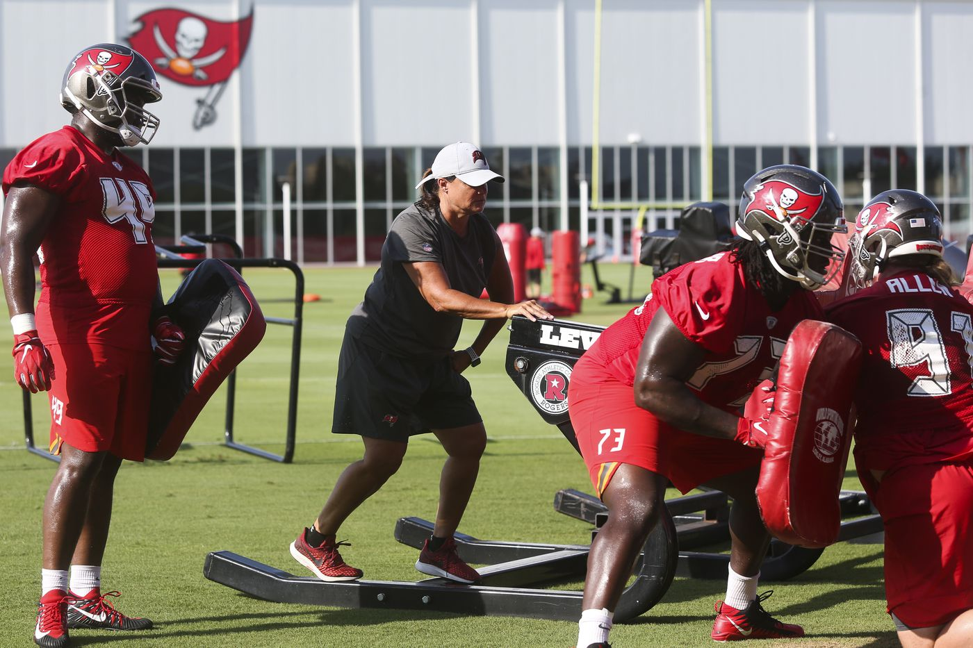 Locust on the sled while running drills with Tampa Bay players during minicamp.