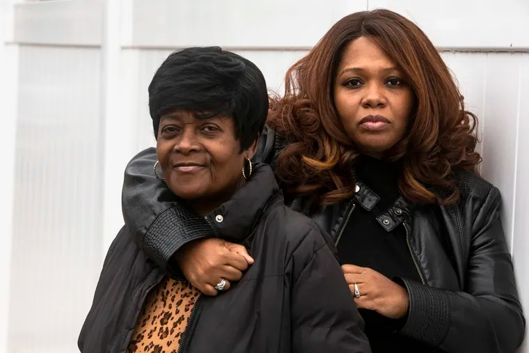 Shameka Sawyer (right) made a film about her brother, who was shot and killed in June. She with her mother, Brenda Sawyer, outside Shameka's home in West Oak Lane.