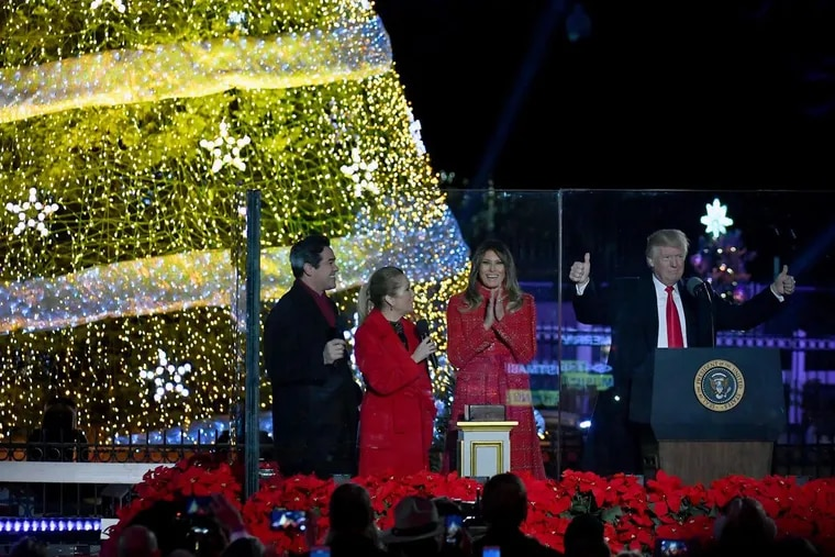 President Trump and first lady Melania Trump kick off the 95th annual National Christmas Tree Lighting with Dean Cain (left) and Kathie Lee Gifford on the Ellipse in Washington on Thursday.