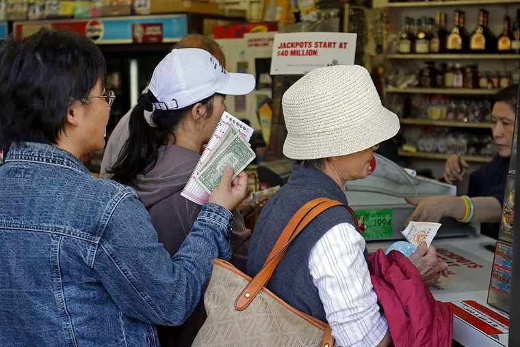 People line up to buy Powerball tickets in the Chinatown district of Oakland, Calif. The jackpot has climbed to $600 million.