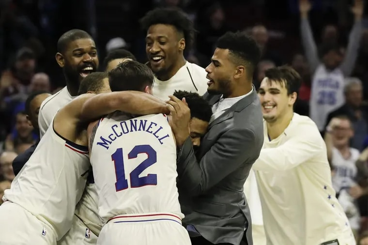Markelle Fultz gets mobbed by his teammates after recording his first career triple-double during the fourth quarter of the Sixers' 130-95 win over the Bucks Wednesday night.