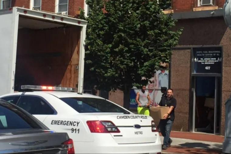 Agents take evidence from the Nueva Vida Behavioral Health Center of N.J. in Camden.