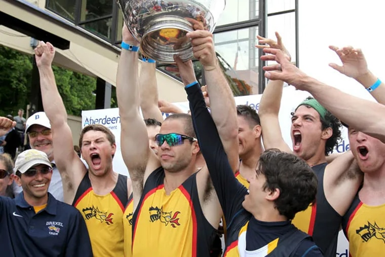 The Drexel University Men's Varsity Heavyweight Eight celebrates as senior captain Kurt Linton (center) raises the Richard O'Brien trophy  after they won the finals in the event at the Dad Vail Regatta on May 11, 2013. (Charles Fox/Staff Photographer)