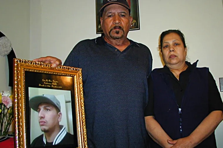 Manuel and Guadalupe Bedolla at their home in West Grove, Chester County. Their son Temo, 27, was stabbed to death in a gang fight. MICHAEL MATZA / Inquirer Staff