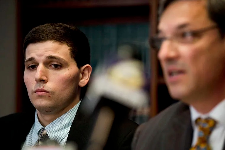 James Vivenzio, left, listens to his attorney Aaron J. Frewiald during a news conference on June 8, 2015, in Philadelphia, Pa. ( AP Photo / Matt Rourke )