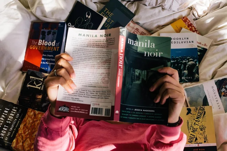 The author with some of her favorite Filipino American books.