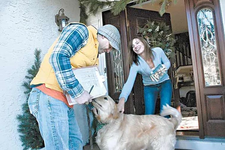 In Haddon Township, N.J., John Friers goes door to door asking folk show many cats and dogs they have. ( April Saul / Staff Photographer )