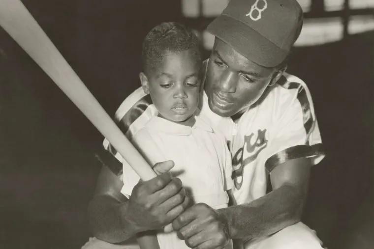 Jackie Robinson with Jackie Jr.