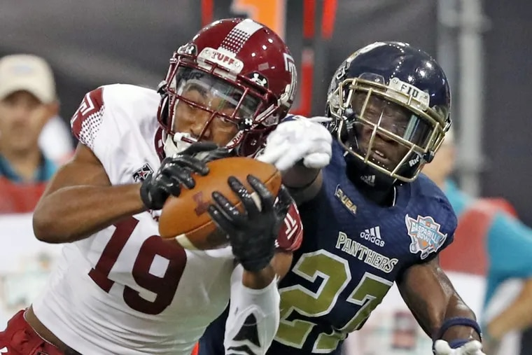 Temple wide receiver Ventell Bryant (19) on a pass reception as Florida International cornerback Brad Muhammad (27) defends during the Bad Boy Mowers Gasparilla Bowl at Tropicana Field in St. Petersburg, Fla., on Thursday, Dec. 21, 2017. (Al Diaz/Miami Herald/TNS)