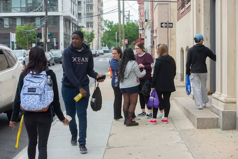 Students leave John W. Hallahan Girls' High School in Philadelphia after taking the SAT test Saturday May 4, 2019.