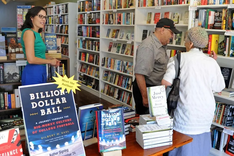 Julie Beddingfield (left) talks with customers Sam and Teresa Semola at Inkwood Books in Haddonfield, which will host authors and children's events.