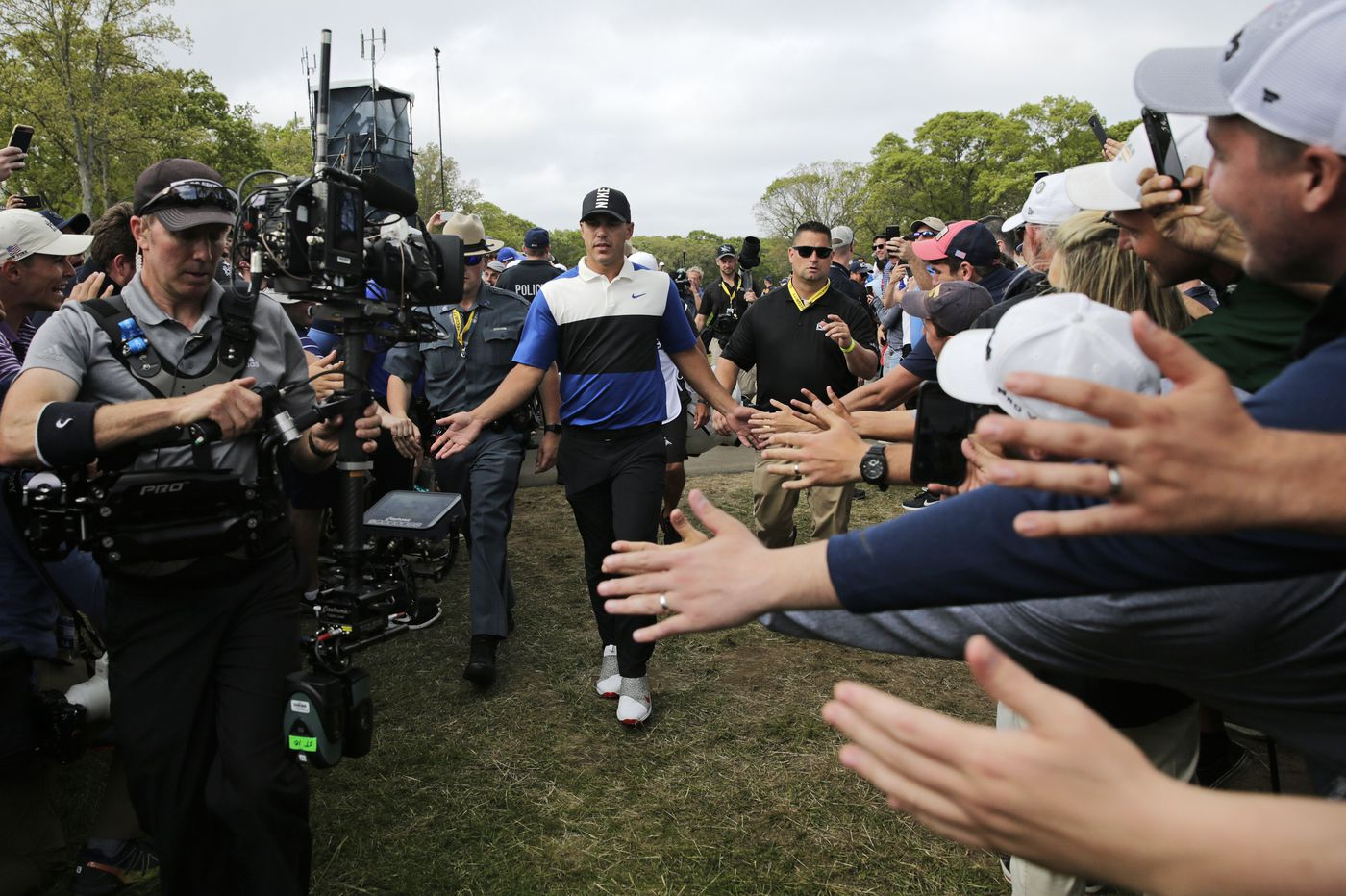 Brooks Koepka watches lead shrink, but holds on to win second straight PGA Championship