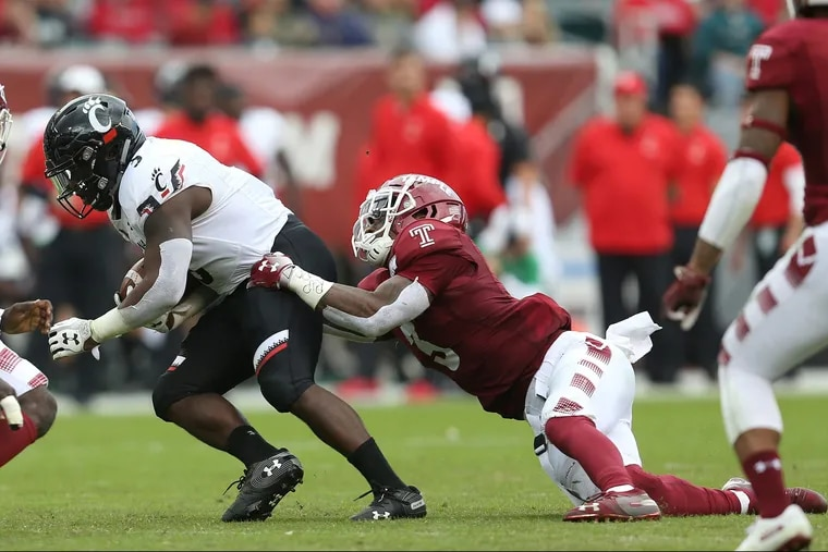 Temple linebacker Chapelle Russell (3) tackles Cincinnati running back Michael Warren II (3) during a game at Lincoln Financial Field in South Philadelphia on Saturday, Oct. 20, 2018. TIM TAI / Staff Photographer