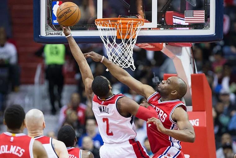 Philadelphia 76ers forward Carl Landry, right, defends Washington Wizards guard John Wall (2) during the first half of an NBA basketball game, on Monday, Feb. 29, 2016, in Washington.