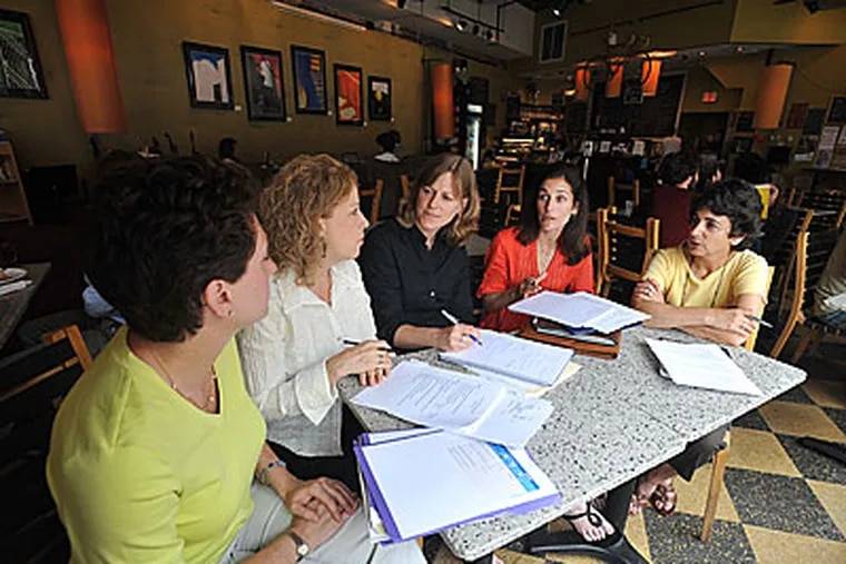 Impact100 Philadelphia held an executive advisory meeting at MilkBoy Coffee in Ardmore. At the meeting are Charlotte Schutzman (left) of Penn Valley, Cheryl Haze of Wynnewood, Mary Broach of Wynnewood, Beth Dahle of Wynnewood, and Ellan Bernstein of Merion Station. Dahle and Broach are co-founders. (Sharon Gekoski-Kimmel / Staff Photographer)
