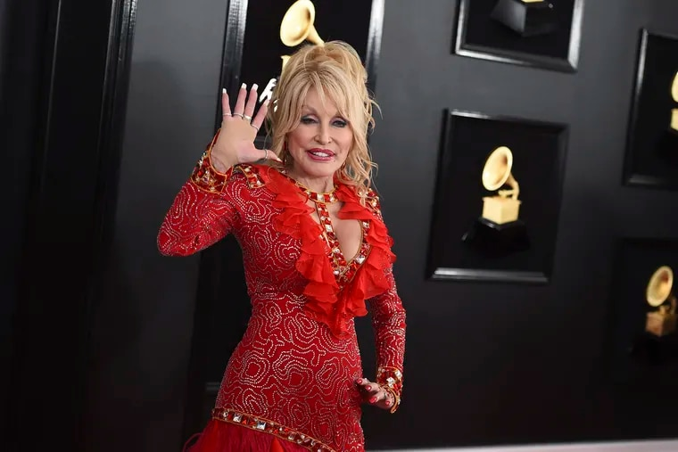 Dolly Parton arrives at the 61st annual Grammy Awards in 2019. Her book giveaway program is expanding to Philadelphia.
