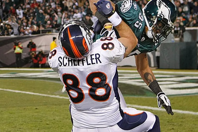 Macho Harris was called for a costly roughing penalty on Denver's Tony Scheffler during the third quarter. (Ron Cortes/Staff Photographer)