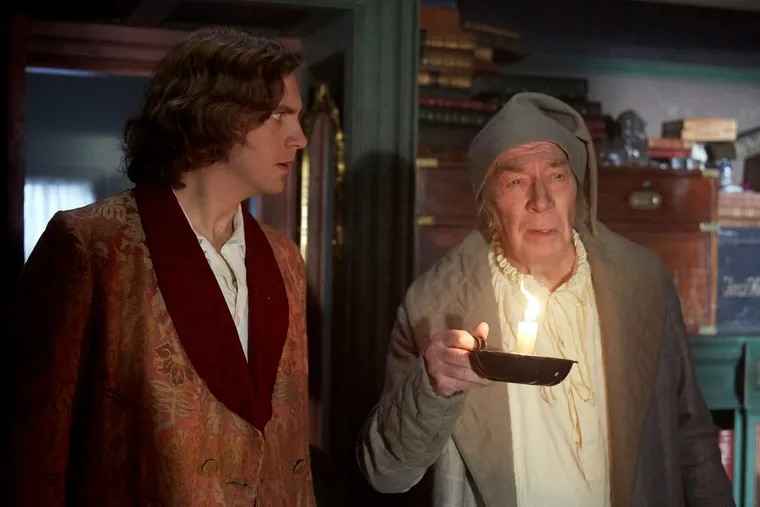 """Dan Stevens (left) stars as Charles Dickens and Christopher Plummer plays Ebenezer Scrooge in """"The Man Who Invented Christmas."""""""
