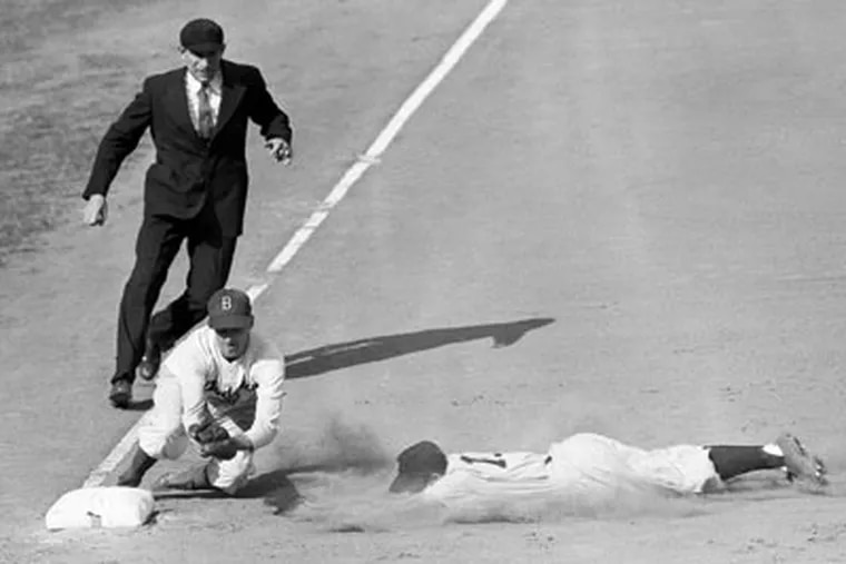 Yankees shortstop Phil Rizzuto is out at third during the first televised World Series in 1947. (John Rooney/AP)