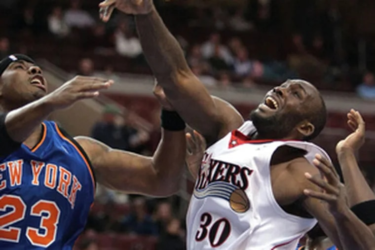 The Sixers' Reggie Evans and the Knicks' Quentin Richardson battle for a rebound. Evans collected 12 rebounds.
