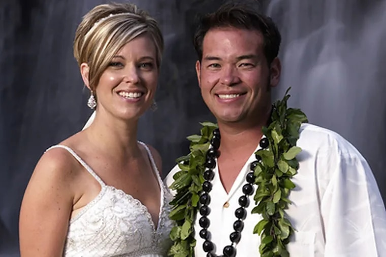 """Reality TV stars, Jon Gosselin, right, and his wife Kate Gosselin, from the TLC series, """"Jon & Kate Plus 8,"""" are shown in Hawaii. The couple has reportedly filed for divorce. (AP Photo/TLC, Mark Arbeit)"""
