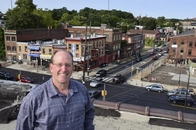 Mount Airy-based developer Ken Weinstein, 53, is on the roof of the Marv Levy building overlooking the intersection of Wayne Avenue and Berkley Street, an area he plans to redevelop.